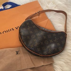 Louis Vuitton vintage purse with duster and bag.